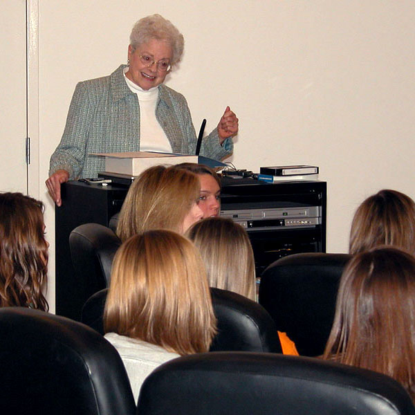 Jane Schulz speaks with a group of students