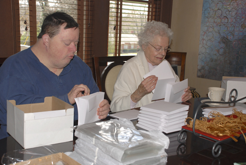 Billy and Jane count envelopes for the notecards decorated with Tom's labyrinth studies.